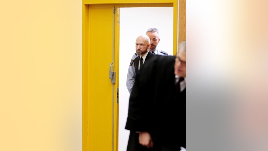 Anders Behring Breivik arrives at his appeal case in Borgarting Court of Appeal at Telemark prison in Skien, Norway, Tuesday, Jan. 10, 2017. Norwegian mass murderer Anders Behring Breivik walked quietly into a courtroom at a high security prison Tuesday, making a neo-Nazi salute, as judges began reviewing a government appeal against a ruling that his solitary confinement was inhumane and violated human rights. (Lise Aaserud/NTB Scanpix via AP)