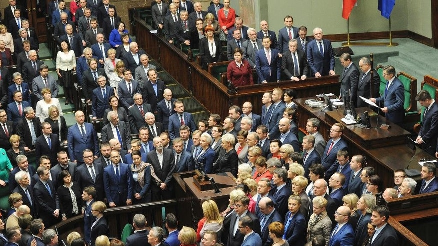 Parliament Speaker Marek Kuchcinski, top second right, opens the parliament session, only to declare a break till Thursday, as opposition lawmakers block the podium, in Warsaw, Poland, Wednesday, Jan. 11, 2017. The parliament's session hall is occupied by a group of opposition lawmakers as they continue a protest since Dec.16, 2016 against the policies of the ruling Law and Justice party, causing delay to the first session of 2017. (AP Photo/Alik Keplicz)