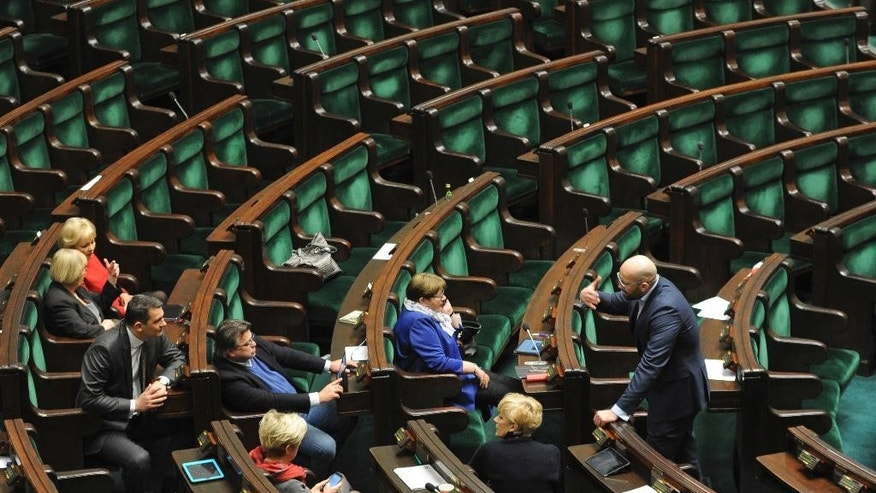 Opposition lawmakers occupy the empty session hall as they continue their protest since Dec. 16 to protest a budget that they say was passed illegally, in the parliament in Warsaw, Poland, Thursday, Jan. 12, 2017. Poland's interior minister says opposition lawmakers blocking the podium in parliament could face fines and possibly even up to 10 years of prison. (AP Photo/Alik Keplicz)
