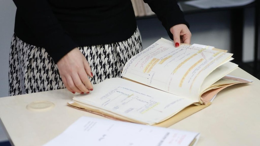 In this picture taken on Tuesday, Jan. 10, 2017, librarian Marcela Strouhalova manages Communist-era secret police files on Czechoslovakia born Ivana Trump, first wife of Donald Trump, at the Security Service Archive in Prague, Czech Republic. According to the files, U.S. President-elect Donald Trump was confident he would win the presidential election in the United States in 1996 as an independent. (AP Photo/Petr David Josek)