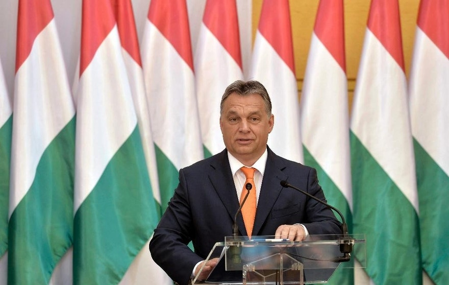 "Hungarian Prime Minister Viktor Orban addresses a conference held on the occasion of the 5th anniversary of the formation of his government in 2010 in the atrium of the Budapest History Museum in Budapest, Hungary, Friday, May 29, 2015. Orban has recognized the far-right Jobbik party as the ""leading opposition party"" and reaffirmed the country's commitment to its membership in the European Union and NATO. (Szilard Koszticsak/MTI via AP)"