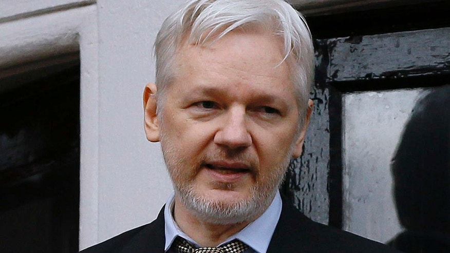FILE - In this Friday Feb. 5, 2016 file photo, Wikileaks founder Julian Assange speaks from the balcony of the Ecuadorean Embassy in London.