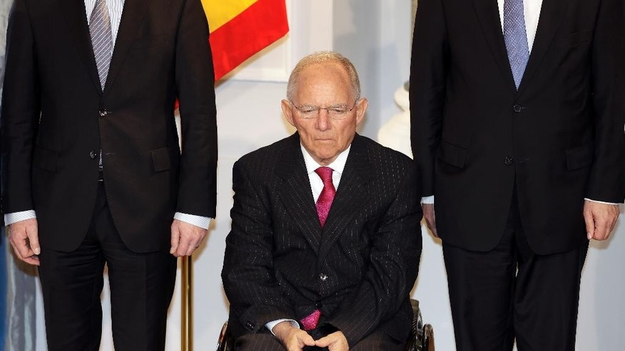 German Finance Minister Wolfgang Schaeuble, center, attends a New Year's reception of German President Joachim Gauck at the Bellevue palace in Berlin, Germany, Tuesday, Jan. 10, 2017. (AP Photo/Michael Sohn)