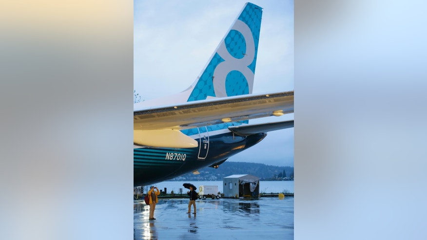 FILE - In this Dec. 8, 2015, the first Boeing 737 MAX airplane to roll off Boeing's assembly line in Renton, Wash. is shown parked before an employee-only rollout event. India's low-cost airline Spicejet plans to buy up to 205 next-generation Boeing planes worth $22 billion in a major deal to expand its domestic and international operations. A joint statement by the two companies Friday, Jan. 13, 2017, said the planes booked at the end of 2016 include 100 new Boeing 737 MAX 8s, 42 MAXs, 13 additional 737 MAXs as well as purchase rights for 50 additional planes. (AP Photo/Ted S. Warren, File)