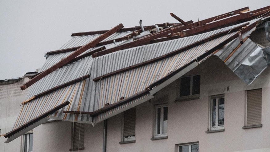 CORRECTS NAME OF CITY TO ERLENSEE  -The debris of a roof of  a house in Erlensee  Germany, photographed Friday Jan. 13, 2017 after strong storms hit parts of Germany.  (Boris Roessler/dpa via AP)