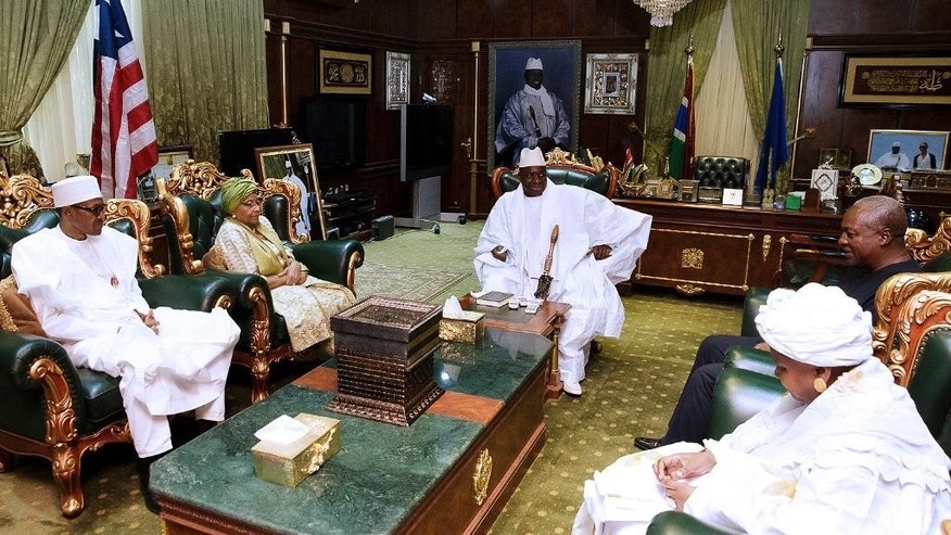 In this photo released by the Nigeria State House, Nigeria President Muhammadu Buhari. left, Liberia President, Ellen Johnson Sirleaf, second from left, Gambia President, Yahya Jammeh, centre, former Ghana President, John Dramani Mahama, and an Unidentified woman during a meeting in Banjul Gambia, Friday Jan.13, 2017 . Nigeria's president was leading a regional delegation to Gambia in a last-ditch attempt Friday to persuade its longtime leader to step down and allow his rival's inauguration next week, while fears grow that the impasse could turn violent. (Bayo Omoboriowo/Nigeria State House via AP)
