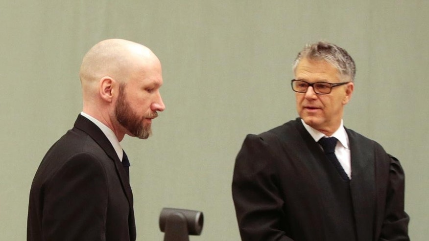 Anders Behring Breivik, left, talks with his lawyer Oystein Storrvik in a courtroom on the fourth day of the appeal case in Borgarting Court of Appeal at Telemark prison in Skien, Norway, Friday, Jan. 13, 2017. Norwegian mass murderer Breivik told a panel of judges Thursday that his solitary confinement in prison had deeply damaged him and made him even more radical in his neo-Nazi beliefs. (Lise Aaserud/NTB scanpix via AP)