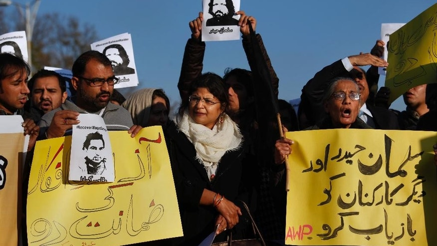 Supporters of Awami Worker Party and civil society members chant slogans during a demonstration to condemn the missing human rights activists, in Islamabad, Pakistan, Tuesday, Jan. 10, 2017. International and local rights groups on Tuesday urged the Pakistani government to investigate the abductions last week of four anti-Taliban activists — disappearances that critics claim reflect a crackdown on secular dissent. (AP Photo/Anjum Naveed)