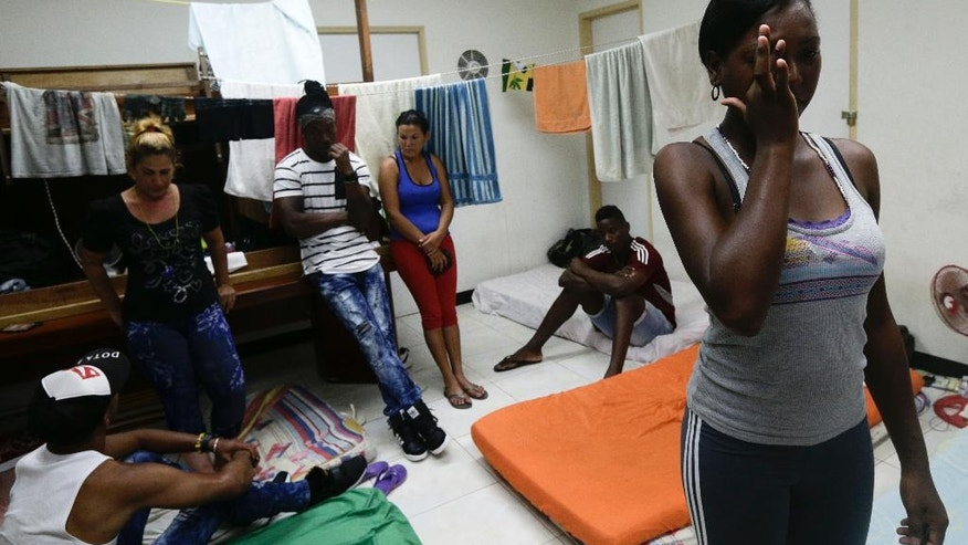 "Cuban migrant Yarisel Isac Wilson, 20, right, cries as she talks about her journey to the U.S. at a migrant shelter in Panama City, Thursday, Jan. 12, 2017. President Barack Obama announced Thursday he is ending a longstanding immigration policy that allows any Cuban who makes it to U.S. soil to stay and become a legal resident. The repeal of the ""wet foot, dry foot"" policy is effective immediately. (AP Photo/Arnulfo Franco)"