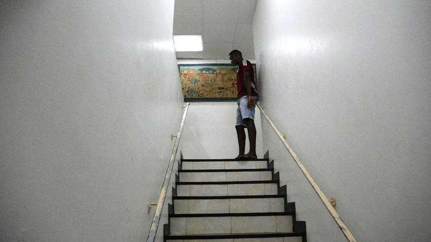 "A Cuban migrant stands a the top of the stairs at a shelter in Panama City, Thursday, Jan. 12, 2017. President Barack Obama announced Thursday he is ending a longstanding immigration policy that allows any Cuban who makes it to U.S. soil to stay and become a legal resident. The repeal of the ""wet foot, dry foot"" policy is effective immediately. (AP Photo/Arnulfo Franco)"