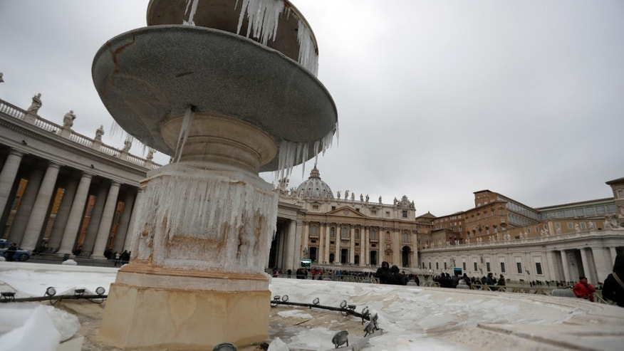 Icicles adorn one of the fountain of St. Peter's Square at the Vatican, Sunday, Jan. 8, 2017, as large areas of Italy are affected by strong winds, snowfall and low temperatures. (AP Photo/Andrew Medichini)