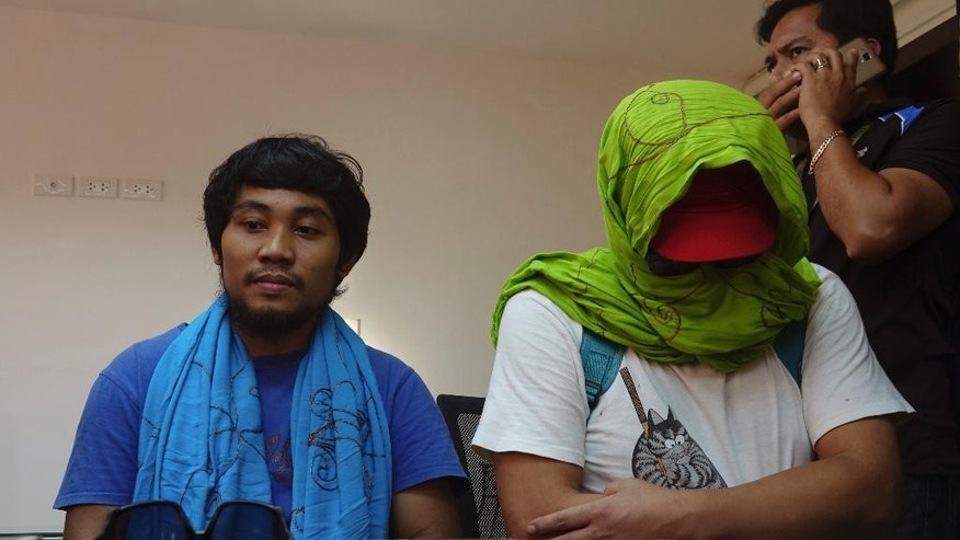 South Korean hostage Park Chul-hong, seated right, and Filipino hostage Glen Alindajao, left, prepare to answer questions after being flown in Davao from Jolo following their release Saturday, Jan. 14, 2017 from their kidnappers in the volatile island of Jolo in southern Philippines. Park and Alindajao were released Saturday after almost three months in captivity. (AP Photo)