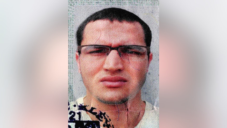 FILE -The photo issued by German federal police on Dec. 21, 2016 shows 24-year-old Tunisian Anis Amri on a photo that was used on the documents found in the truck that plowed into a Christmas market in Berlin Dec. 19. AVolker Kauder, a senior ally of German Chancellor Angela Merkel says he's open to launching a parliamentary inquiry into whether authorities made mistakes in handling the Tunisian man who drove a truck into a  Christmas market in Berlin. Attacker Anis Amri had been rejected for asylum but authorities had been unable to deport him. (German police via AP,file)