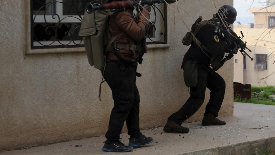 Iraqi special forces fight against Islamic State militants to regain control of Mosul University, in the eastern side of Mosul, Iraq, Saturday, Jan. 14, 2017. (AP Photo/ Khalid Mohammed)