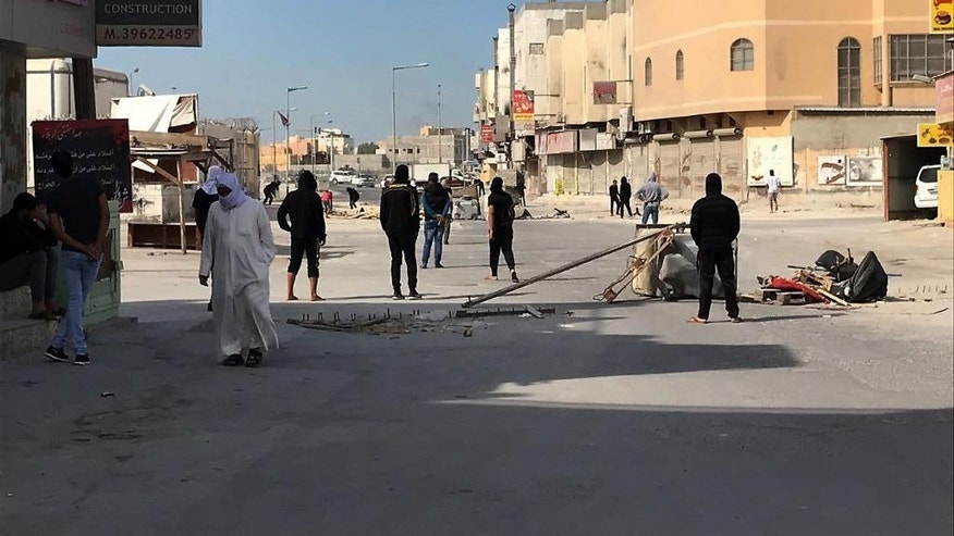 Anti government protestors block the road in the Jidhafs district of Bahrain, Sunday Jan. 15, 2017, after authorities executed three men this morning they found guilty of a deadly attack on police, the kingdom's first executions since an Arab Spring-inspired uprising rocked the country in 2011. (AP Photo)