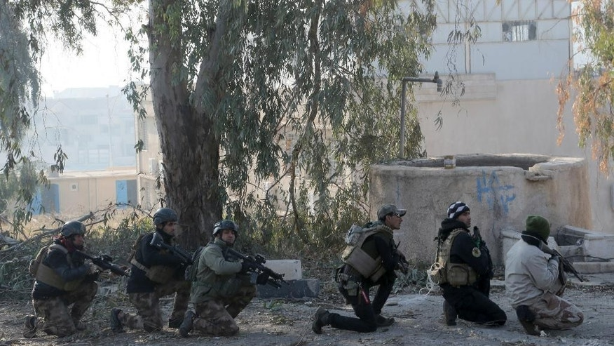 Iraqi special forces advance inside Mosul University grounds, during fighting against Islamic State militants in the eastern side of Mosul, Iraq, Saturday, Jan. 14, 2017. (AP Photo/ Khalid Mohammed)
