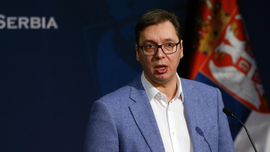 Serbian Prime Minister Aleksandar Vucic speaks during a press conference in Belgrade, Serbia, Saturday, Jan. 14, 2017. A Serbian train, sent to Kosovo despite protests from the government in Pristina which called it a violation of its sovereignty, was stopped at the border on Saturday, triggering a dramatic escalation of tensions between the former wartime foes.  (AP Photo/Darko Vojinovic)