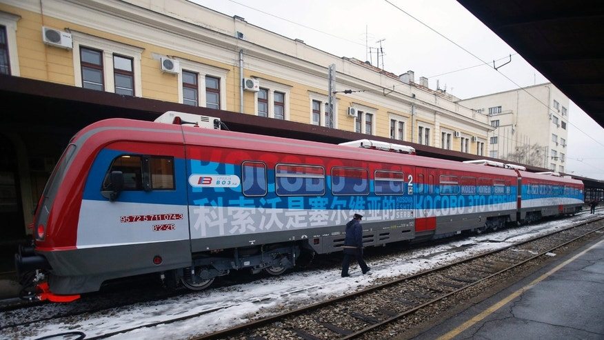 "Jan. 14, 2017: A railroad worker walks by the first train decorated with letters that read ""Kosovo is Serbian"" written in twenty languages departing from the Belgrade to Mitrovica, Kosovo at Belgrade's railway station, Serbia."