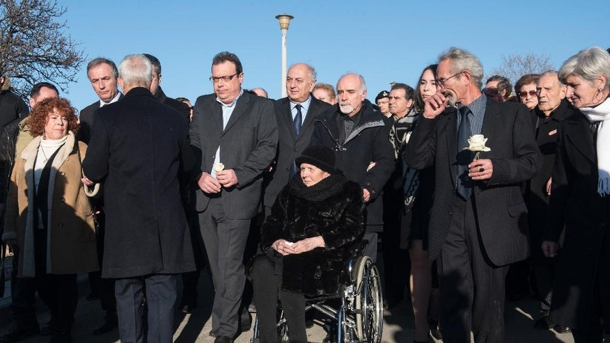 Mother of Greek late ambassador to Brazil Kyriakos Amiridis, Polymnia Amiridou, center, attends the funeral of her son, at the northern Greek city of Thessaloniki, Sunday, Jan. 15, 2017. Police have said they believe Amiridis, whose charred body was found in a car in Brazil, was killed by his wife's lover under her orders. (AP Photo/Giannis Papanikos)