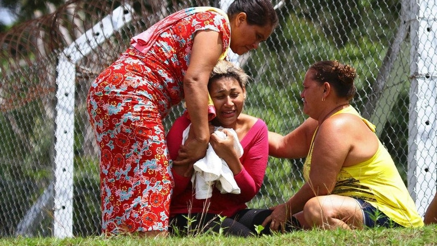 FILE - In this Jan. 2, 2017 file photo, the wife of an inmate who was killed in a prison riot cries outside Anisio Jobim Penitentiary Complex in Manaus, Brazil where dozens of inmates died in the northern state of Amazonas. Brazilian authorities are scrambling to find ways to stop a wave of prison violence that has killed at least 125 inmates in two weeks, many decapitated and with their hearts and intestines ripped out. (Edmar Barros/Futura Press via AP, File) NAO PUBLICAR NO BRASIL