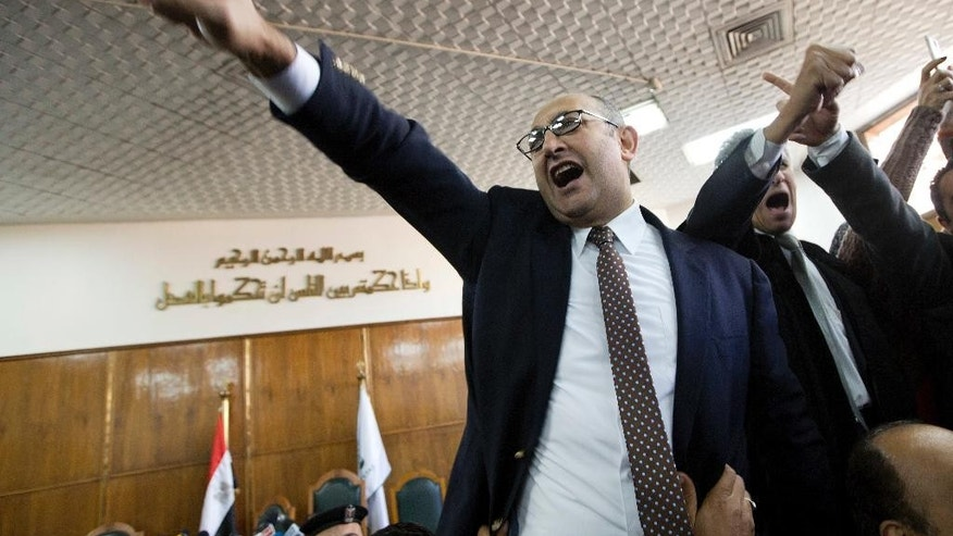 Egyptian lawyer and former presidential candidate Khaled Ali celebrates after the Supreme Administrative Court said two islands, Sanafir and Tiran, are Egyptian, debunking the government's claim that they were Saudi, in Cairo, Egypt, Monday, Jan. 16, 2017. An Egyptian court has ruled against the government's decision to hand over two Red Sea islands to Saudi Arabia, a landmark verdict likely to deepen tension with the kingdom. (AP Photo/Amr Nabil)