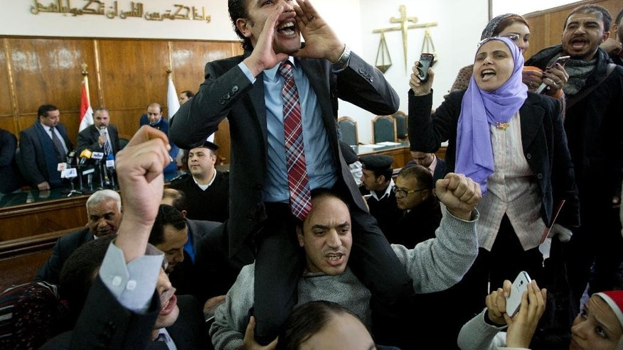 Prominent rights lawyer Malek Adly, shouts slogans after the Supreme Administrative Court said that two islands, Sanafir and Tiran, are Egyptian, debunking the government's claim that they were Saudi, in Cairo, Egypt, Monday, Jan. 16, 2017. An Egyptian court has ruled against the government's decision to hand over two Red Sea islands to Saudi Arabia, a landmark verdict likely to deepen tension with the kingdom.  (AP Photo/Amr Nabil)