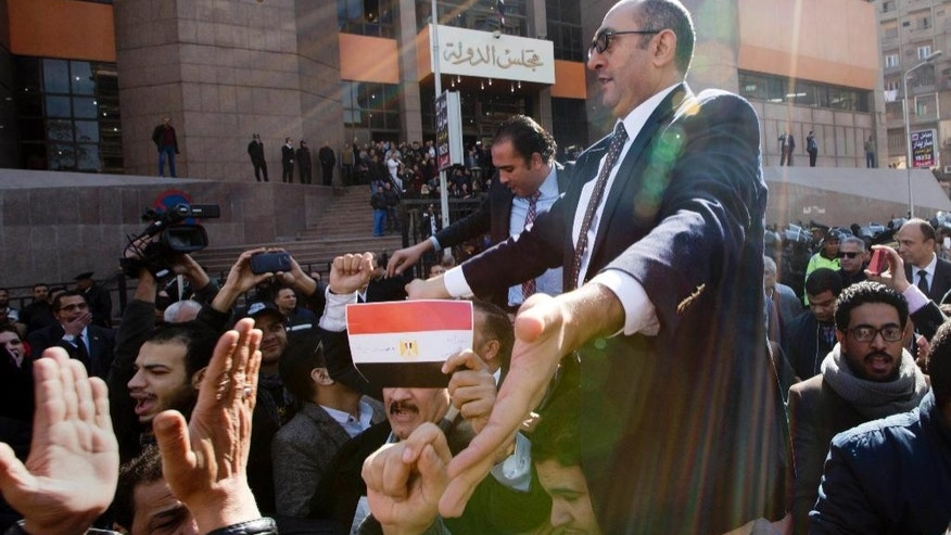 Lawyer and former presidential candidate Khaled Ali, center, celebrates with others after the Supreme Administrative Court said two islands, Sanafir and Tiran, are Egyptian, debunking the government's claim that they were Saudi, in Cairo, Egypt, Monday, Jan. 16, 2017. An Egyptian court has ruled against the government's decision to hand over two Red Sea islands to Saudi Arabia, a landmark verdict likely to deepen tension with the kingdom. (AP Photo/Amr Nabil)