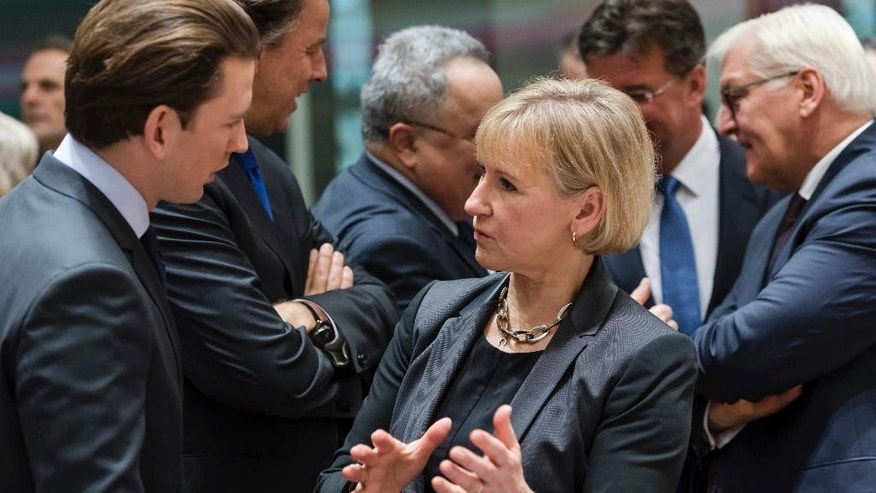 Sweden's Foreign Minister Margot Wallstrom, right, talks with Austria's Foreign Minister Sebastian Kurz during an EU foreign ministers meeting at the EU Council in Brussels on Monday, Jan. 16, 2017. (AP Photo/Geert Vanden Wijngaert)