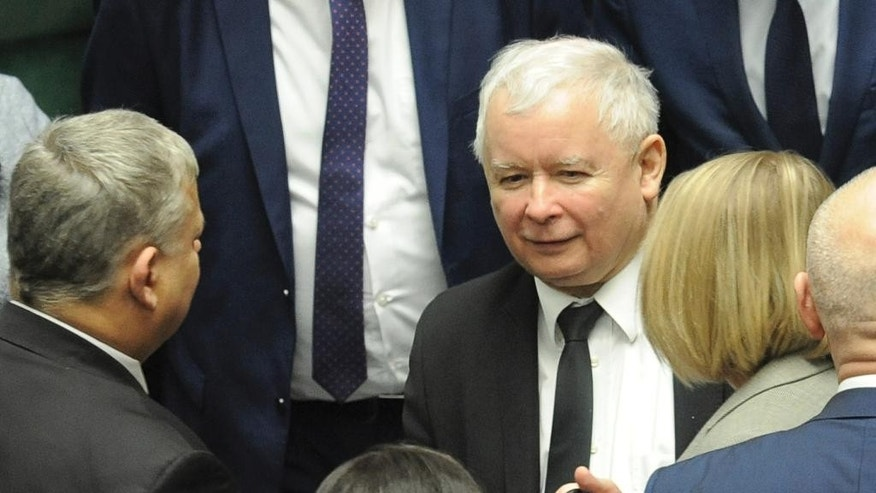 Jaroslaw Kaczynski, center, leader of the ruling Law and Justice party, speaks with lawmakers during a parliament session after opposition lawmakers ended their protest in Warsaw, Poland, Thursday, Jan. 12, 2017. The parliament session hall was occupied by opposition lawmakers in a protest against the budget vote that was according to them illegal. (AP Photo/Alik Keplicz)
