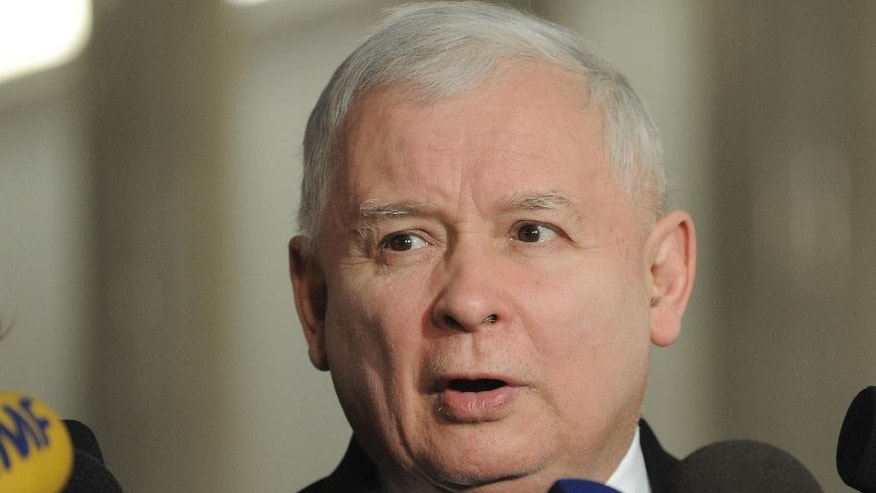 Jaroslaw Kaczynski, leader of the ruling Law and Justice party speaks to journalists in the parliament in Warsaw, Poland, Wednesday, Jan. 11, 2017. The parliament's session hall is occupied by a group of opposition lawmakers as they continue a protest since Dec.16, 2016 against the policies of the ruling Law and Justice party, causing delay of the first session of 2017. (AP Photo/Alik Keplicz)