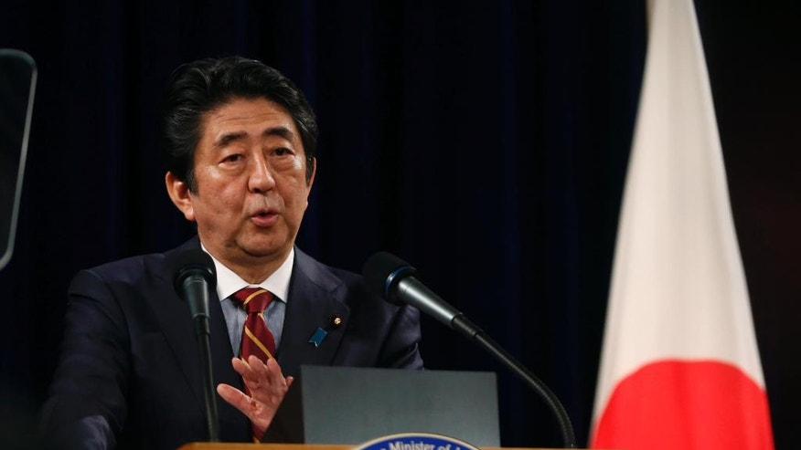 Japanese Prime Minister Shinzo Abe speaks during a press conference in Hanoi, Vietnam, Monday, Jan. 16, 2017. Japan will provide Vietnam new patrol vessels, Abe said Monday on the last stop of his four-nation tour to boost his country's trade and security engagements in Asia amid China's rising dominance. (Kham/Pool Photo via AP)