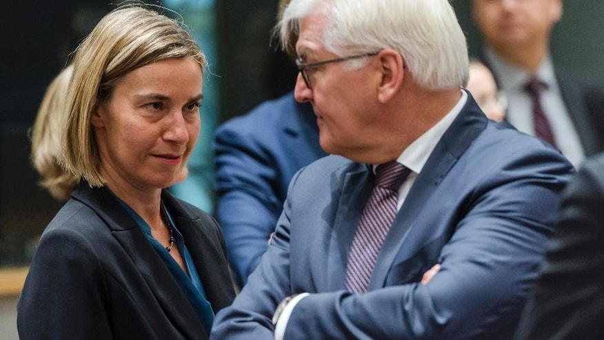 EU foreign policy chief Federica Mogherini, left, talks with German Foreign Minister Frank-Walter Steinmeier during an EU foreign ministers meeting at the EU Council in Brussels on Monday, Jan. 16, 2017. (AP Photo/Geert Vanden Wijngaert)