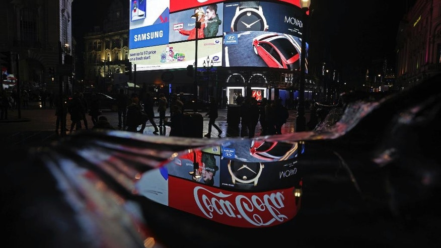 A general view of the advertising screens at Piccadilly Circus, central London, Sunday Jan. 15, 2017, before they were switched off in preparation for redevelopment. The iconic lights have gone out so that the electronic hoardings can be replaced with a state-of-the-art screen measuring 790 square metres which is expected to be unveiled in the autumn.  (Yui Mok/PA via AP)
