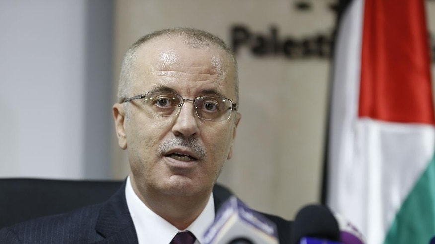 Palestinian Prime Minister Rami Hamdallah speaks during a press conference about the power crisis in the Gaza Strip in the West Bank city of Ramallah, Monday, Jan. 16, 2017. Fuel from Qatar arrived to the Gaza Strip on Monday, helping to ease a crippling power shortage that has sparked rare demonstrations against the territory's Hamas rulers, who have responded with a crackdown on protesters. Gaza's power authority said Qatari-bought diesel will double the amount of power provided to Gazan households. Gaza has been experiencing the worst electricity shortage in years, limiting Gazans to about four hours of electricity per day. (AP Photo/Majdi Mohammed)