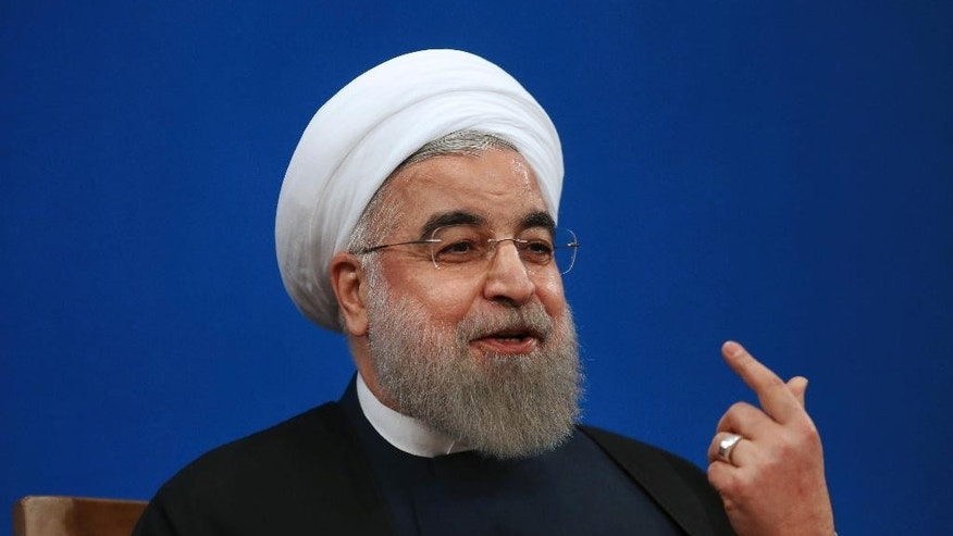 "Iranian President Hassan Rouhani gestures as he speaks in a press conference at the presidency compound in Tehran, Iran, Tuesday, Jan. 17, 2017. Iran's president has compared talk of renegotiating its nuclear accord to ""converting a shirt back to cotton,"" and says U.S. President-elect Donald Trump's talk of doing so is ""mainly slogans."" (AP Photo/Vahid Salemi)"