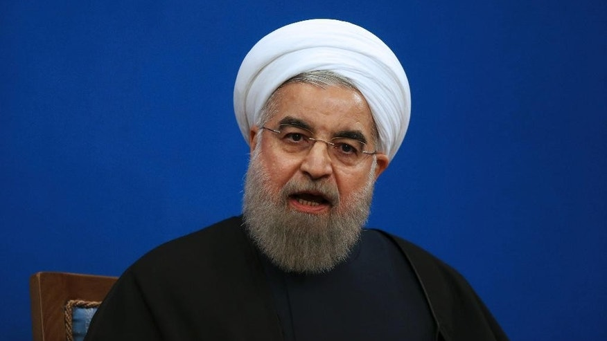 "Iranian President Hassan Rouhani speaks in a press conference at the presidency compound in Tehran, Iran, Tuesday, Jan. 17, 2017. Iran's president has compared talk of renegotiating its nuclear accord to ""converting a shirt back to cotton,"" and says U.S. President-elect Donald Trump's talk of doing so is ""mainly slogans."" (AP Photo/Vahid Salemi)"