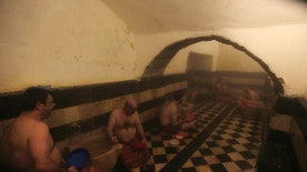 In this Monday, Jan. 16, 2017 photo, men bathe at the 1,000-year-old Hammam al-Malik al Zahir bath in the old city of Damascus, Syria. Water cut-offs have been almost continuous since Dec. 22, in the worst water crisis known to Damascus residents. It comes at a time when the country is suffering electricity cuts and lack of other services as Syria's conflict approaches its sixth year in March. (AP Photo/Hassan Ammar)
