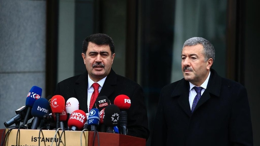 Istanbul Gov. Vasip Sahin, left, accompanied by Police Chief Mustafa Caliskan, talks to the media during a news conference regarding the arrest of a suspect of New Year's nightclub attack in Istanbul, Tuesday, Jan. 17, 2017. Police said they had caught the gunman who killed 39 people at the attack on a nightclub in Istanbul during New Year's celebrations. Sachin said it's clear that the attack was carried out on behalf of the Islamic State group. (AP Photo/Lefteris Pitarakis)