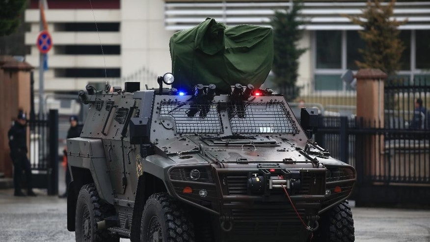 A Turkish police armored vehicle is driven into Istanbul's headquarters prior to a news conference regarding the arrest of a suspect of New Year's nightclub attack, in Istanbul, Tuesday, Jan. 17, 2017. Turkish officials on Tuesday confirmed that the gunman who carried out the deadly New Year's attack on an Istanbul nightclub, which was claimed by the Islamic State group, has been detained. (AP Photo/Lefteris Pitarakis)
