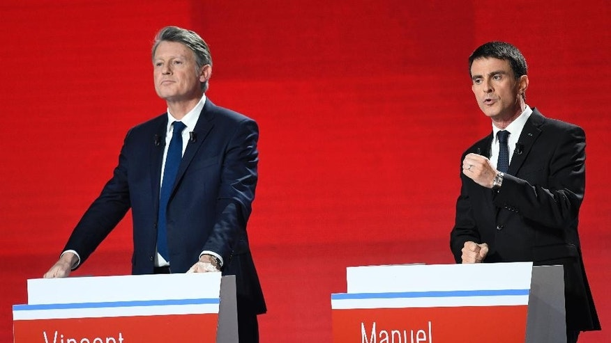 Candidates for the French left's presidential primaries ahead of the 2017 presidential election, Vincent Peillon, left, and Manuel Valls take part in the second televised debate in Paris, France, Sunday, Jan. 15, 2016. Seven competitors are bidding to be the Socialist Party's candidate in next spring's French presidential election. (Bertrand Guay/Pool Photo via AP)