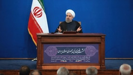 """Iranian President Hassan Rouhani speaks in a press conference at the presidency compound in Tehran, Iran, Tuesday, Jan. 17, 2017. Iran's president has compared talk of renegotiating its nuclear accord to """"converting a shirt back to cotton,"""" and says U.S. President-elect Donald Trump's talk of doing so is """"mainly slogans."""" (AP Photo/Vahid Salemi)"""