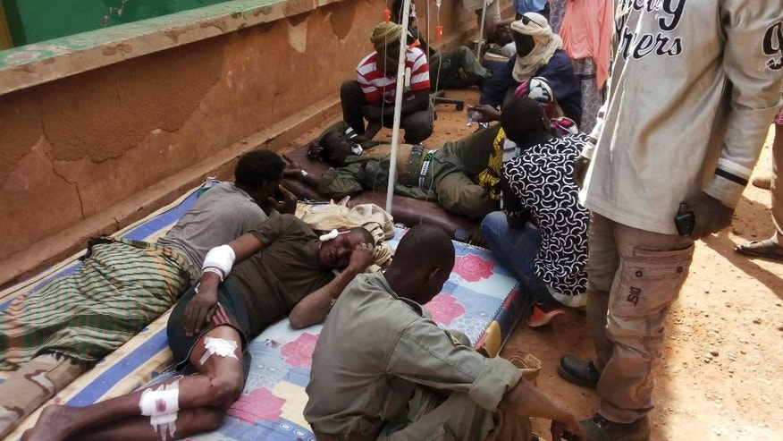 Wounded Malian troops receive medical treatment after being injured by an explosion at the Joint Operational Mechanism base in Gao, Mali, Wednesday, Jan. 18, 2017. A suicide bomber in an explosives-laden vehicle attacked a camp in northern Mali on Wednesday, killing more than 50 people and wounding more than 100 soldiers and former fighters now trying to stabilize the region. (AP Photo/Yacouba Cisse)