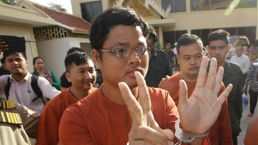 Convicted members of the opposition Cambodia National Rescue Party (CNRP) arrive at Supreme Court, in Phnom Penh, Cambodia, Wednesday, Jan. 18, 2017. Cambodia's Supreme Court on Wednesday held its hearing on convicted members of CNRP who were sentenced from 7 to 20 years in prison for leading a violent protest in 2014. (AP Photo/Heng Sinith)