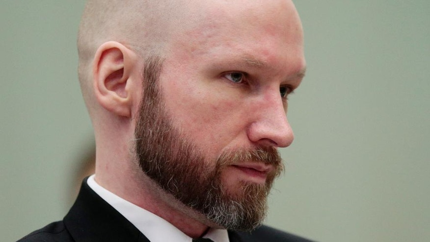 Anders Behring Breivik looks on during the last day of his appeal case in Borgarting Court of Appeal at Telemark prison in Skien, Norway, Wednesday, Jan. 18, 2017. Norway has defended the prison conditions under which mass murderer Anders Behring Breivik is being held. The state attorney presented its closing statement in an appeals trial against a lower court ruling that found that Breivik's isolation in prison violated his human rights. (Lise Aaserud/NTB Scanpix via AP)