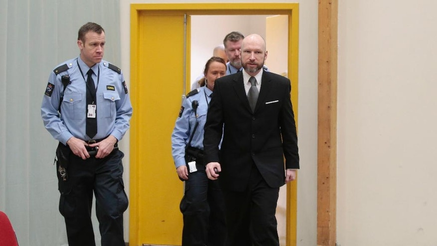 Anders Behring Breivik arrives for the last day of his appeal case in Borgarting Court of Appeal at Telemark prison in Skien, Norway, Wednesday, Jan. 18, 2017. Norway has defended the prison conditions under which mass murderer Anders Behring Breivik is being held. The state attorney presented its closing statement in an appeals trial against a lower court ruling that found that Breivik's isolation in prison violated his human rights. (Lise Aaserud/NTB Scanpix via AP)