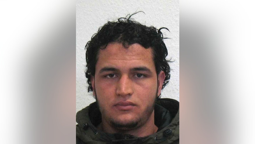 The wanted photo issued by German federal police on Wednesday, Dec. 21, 2016 shows 24-year-old Tunisian Anis Amri. Swiss authorities said Wednesday, Jan. 18, 2017 the gun used by Berlin attacker Anis Amri was imported to Switzerland in the early 1990s. Investigators are still trying to figure out how Amri got hold of the .22-caliber handgun made by now-defunct German manufacturer Erma. (German police via AP)