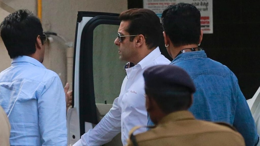Bollywood actor Salman Khan arrives at his home in Mumbai, India, Wednesday, Jan. 18, 2017. Khan was acquitted Wednesday of the charge of using unlicensed arms while hunting for rare blackbucks in a wildlife preserve 18 years ago. (AP Photo/Rafiq Maqbool)