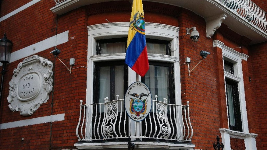 An Ecuadorian national flag flies the embassy where WikiLeaks founder Julian Assange has been holed up for more than four years in London, Wednesday, Jan. 18, 2017. U.S. President Barack Obama's decision Tuesday to commute Chelsea Manning's sentence brought fresh attention to another figure involved in the Army leaker's case: Julian Assange. (AP Photo/Frank Augstein)