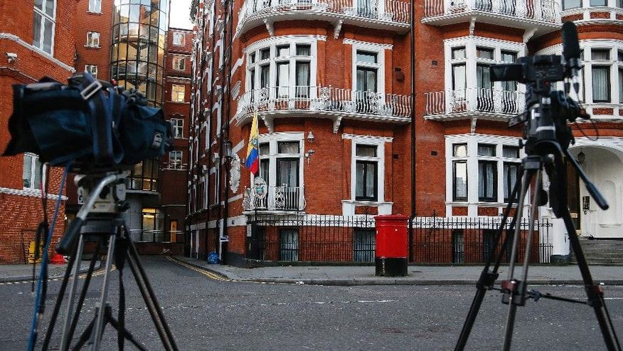 Cameras point at the Ecuadorian embassy where WikiLeaks founder Julian Assange has been holed up for more than four years in London, Wednesday, Jan. 18, 2017. U.S. President Barack Obama's decision Tuesday to commute Chelsea Manning's sentence brought fresh attention to another figure involved in the Army leaker's case: Julian Assange. (AP Photo/Frank Augstein)