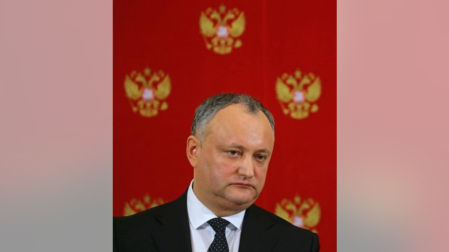 "Moldovan President Igor Dodon attends a joint news conference with Russian President Vladimir Putin in the Kremlin in Moscow, Russia, Tuesday, Jan. 17, 2017. Moldova's new president, who is visiting Russia on his first trip abroad, is voicing hope for rebuilding ""strategic"" ties with Moscow. (Sergei Ilnitsky/Pool Photo via AP)"